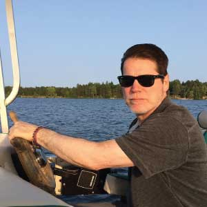 Ladro Profiles Bob Ohly, CFO at Caffe Ladro who enjoys a boat ride in Minnesota
